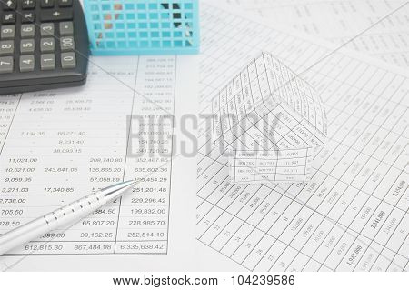 Silver Pen With House Have Calculator And Blue Basket