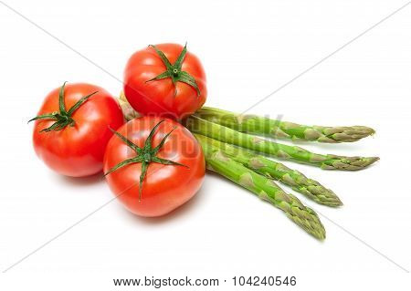 Ripe Tomatoes And Asparagus Isolated On A White Background