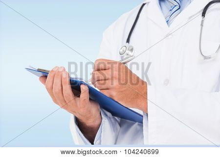Doctor writing on clipboard against blue vignette background