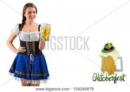 Pretty oktoberfest girl smiling at camera holding beer against oktoberfest graphics