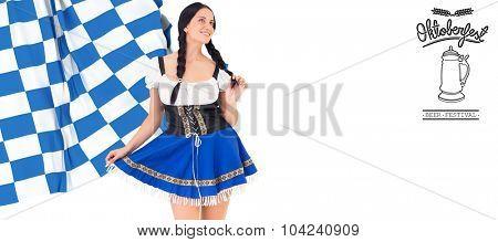 Pretty oktoberfest girl posing and smiling against oktoberfest graphics