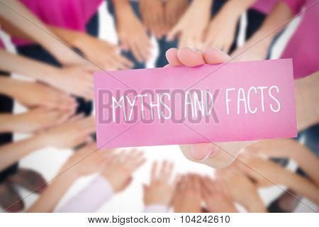 The word myths and facts and young woman holding blank card against oktoberfest graphics