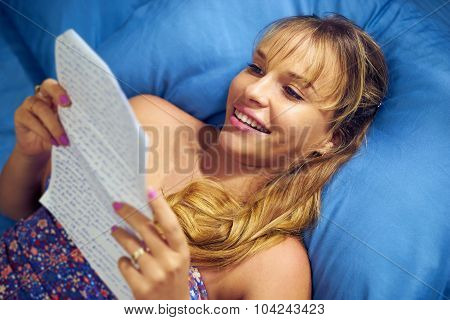 Girl In Love Reading Letter From Boyfriend