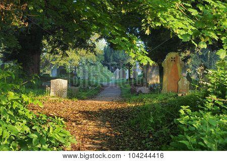 Graveyard in morning sun West Wycombe UK