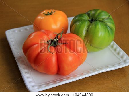 Heritage tomatoes on white plate