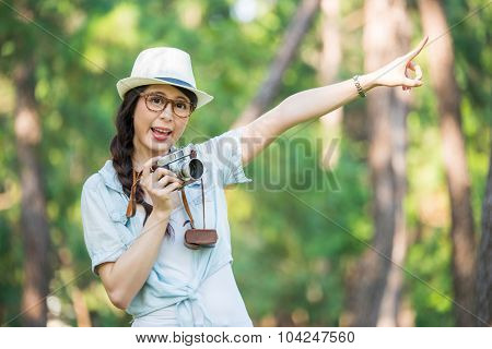 Beautiful Young Girl Cheerful With Retro Camera Photographing, Pointing