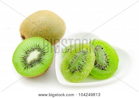 Dried Kiwi In White Dish And Fresh Kiwi.