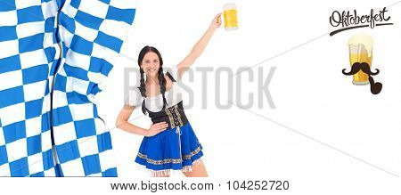Pretty oktoberfest girl holding beer tankard against oktoberfest graphics