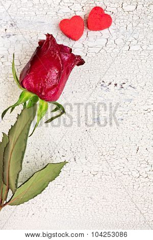 Single Red Rose With Two Small Red Cookies In Shape Of Heart, On Old White Wooden Background, Top Vi