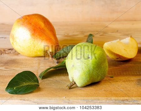 Ripe Pears And Green Pear