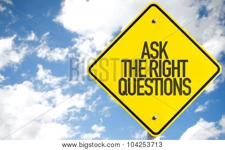 Ask The Right Questions sign with sky background