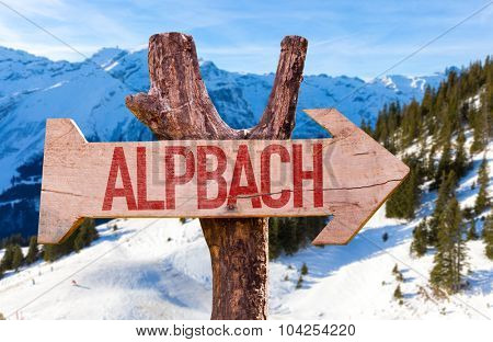 Alpbach wooden sign with winter background