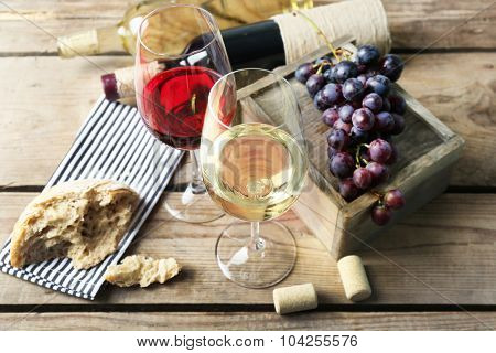 Still life of wine and bread on wooden t background