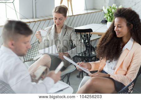 Businesspeople Sitting Together During Lunch