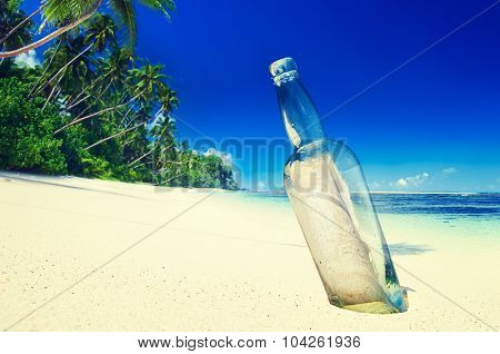 Message in a Bottle on Beach Summer Paradise Concept