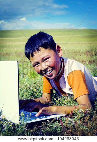 Mongolian Boy Laptop Grass Technology Connection Concept