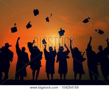 Group Students Celebrating Graduation Silhouette Concept