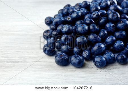 Fresh blueberries on wooden table close up