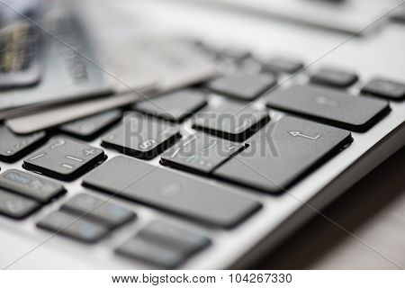 online shopping or internet shop concepts, with bank card or credit card on computer keyboard
