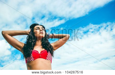 Long Hair Girl Standing Outdoor With Sky On Background