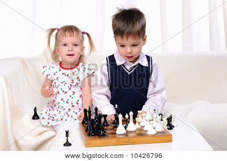 Brother and sister playing chess
