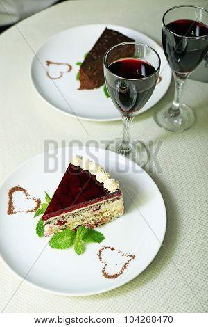 piece of chocolate cake and wine glass
