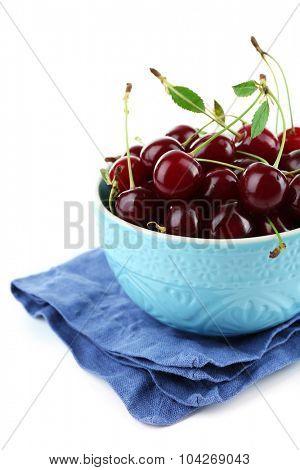 Cherries in mug isolated on white