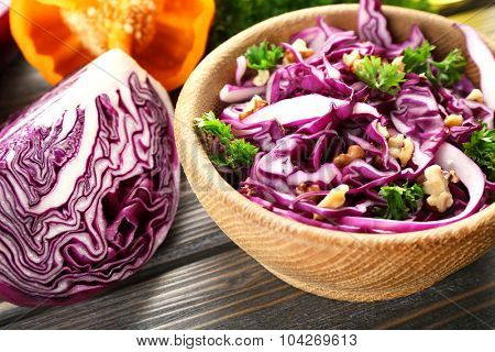 Red cabbage salad served on plate closeup