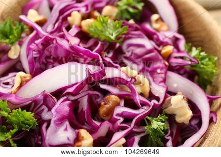Red cabbage salad in bowl closeup