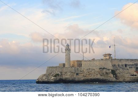 View of el morro fortress in havana bay at sunset, cuba