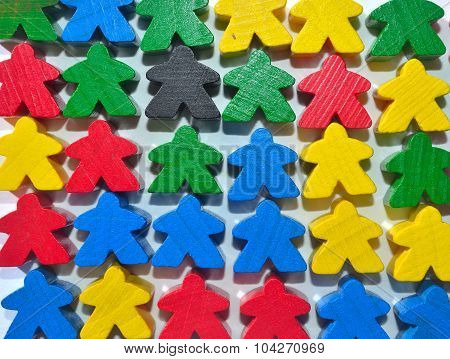 Little multi coloured wooden human figures or meaples