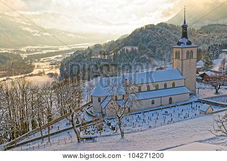 Snow-covered Mountain Landscape With The Church In The Foreground