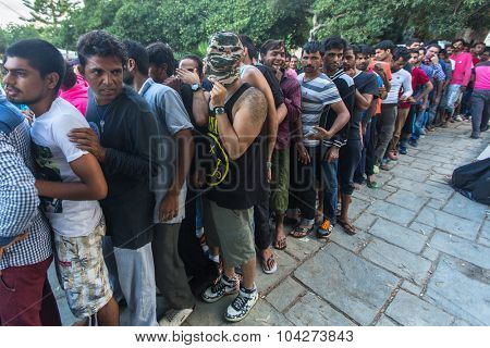 KOS, GREECE - SEP 28, 2015: War refugees receive humanitarian assistance. More than half are migrants from Syria, but there are refugees from other countries-Afghanistan, Pakistan, Iraq, Iran.