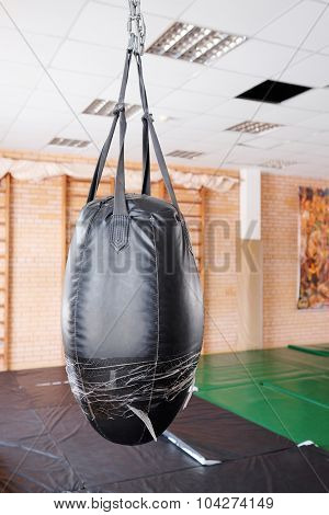 Black punching bag for boxing or kick boxing sport