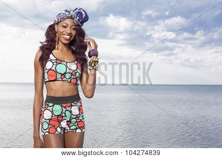Young beuatiful African American girl relaxing at the beach.