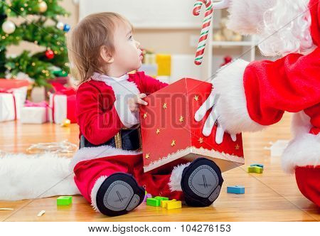 Little Toddler Girl Receiving A Gift From Santa Claus