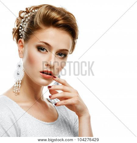 Portrait Of A Girl In A White Dress And Jewelry In A High Key.