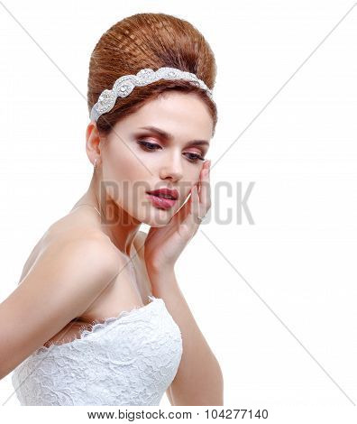 Portrait Of A Beautiful Woman In Wedding White Dress, Hand Touching Face.