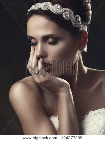 Beautiful Woman In A White Dress In The Image Of A Bride With A Sad Face.