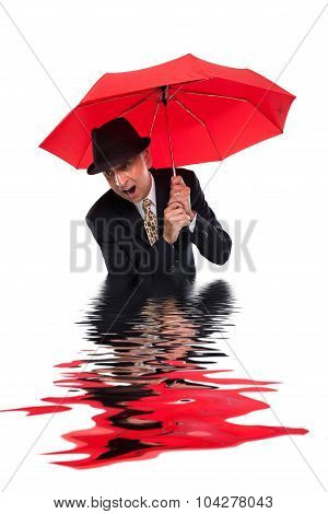 Business man with umbrella getting flooded