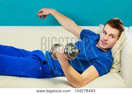 Young Man Fit Body Relaxing On Couch After Training