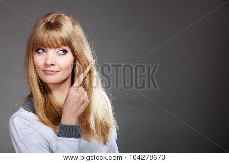 Woman Combing Her Hair With Comb