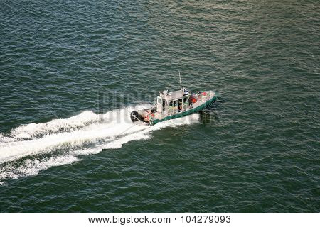 ORLANDO, FLORIDA- SEPTEMBER 26, 2015: Sheriff Vessel Patrols the waterways as a Cruise Ship leaves port.