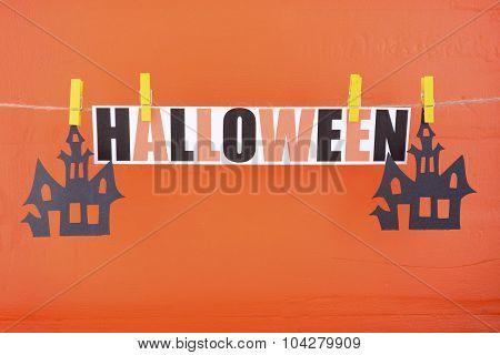 Halloween Party Bunting On Orange Wood Wall.