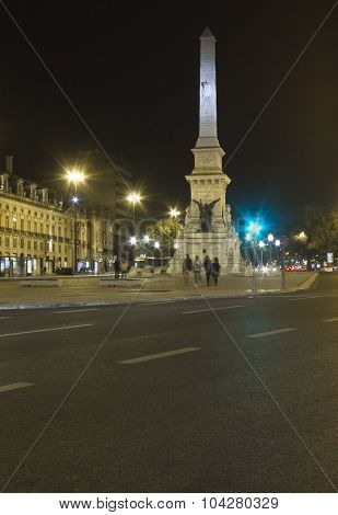 Night View Of Restorers Square In Lisbon
