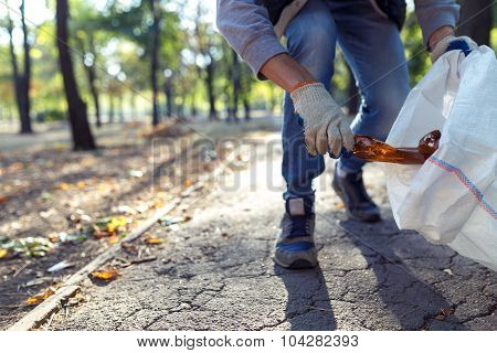 Young Man Picking Up Trash