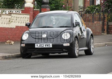 Black Volkswagen New Beetle Car