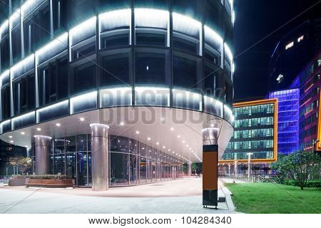 exterior of a modern shopping mall at night
