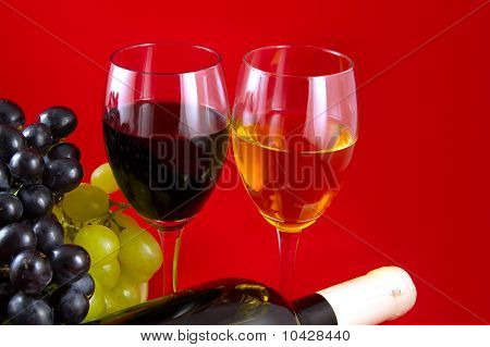 Red And White Wines And Grapes.