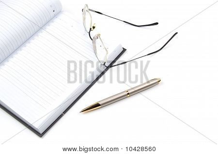 Daily Planner, Pen And Eyeglasses